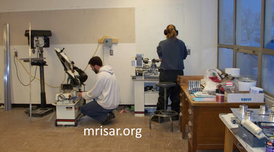 MRISAR's Team member Autumn Siegel and Michael Cook fabricating Robotic Arm exhibits.