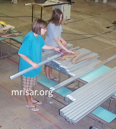 MRISAR Team members Autumn and Aurora Siegel fabricating Robotic exhibits. They are the youngest members of the MRISAR team and began their apprenticeship as preschoolers.