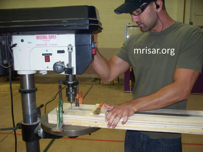 MRISAR's Team member Michael Cook fabricating Robotic exhibits.