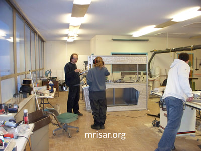 MRISAR Team members Autumn Siegel, John Siegel  and Michael Cook fabricating Robotic exhibits.