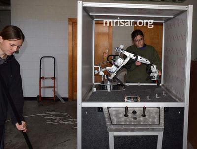MRISAR's Team members installing our base mounted 3 Finger Robotic Arms into the exhibit cases we made. We have been making exhibit robotics since 1991.