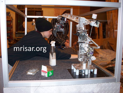 MRISAR Team members Autumn and John Siegel fabricating Robotic exhibits.