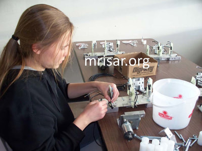 MRISAR's Team member Autumn Siegel fabricating Robotic Arm exhibits.