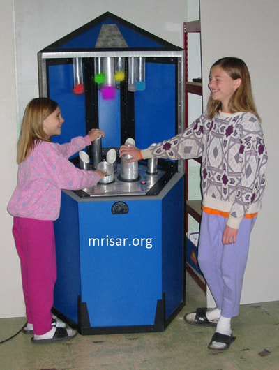 Science Exhibit; MRISAR's team members Aurora & Autumn Siegel testing a Photonic Spectrum exhibit. They have been making them since 2001.