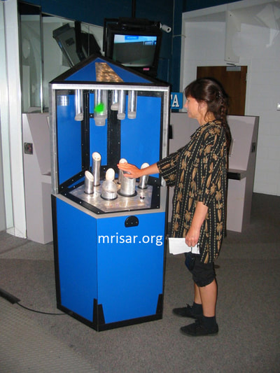 Science Exhibit; MRISAR's team member Victoria testing a Photonic Spectrum exhibit. They have been making them since 2001.