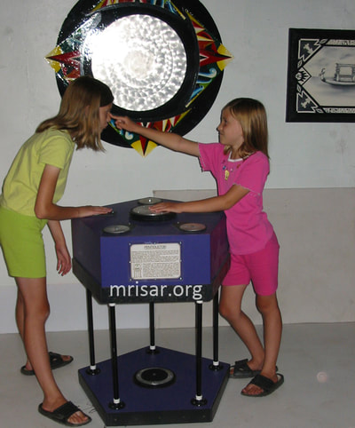 MRISAR's team members Autumn and Aurora Siegel, in 2003 testing our Pentiductor Exhibit. We have been making them since 1993.