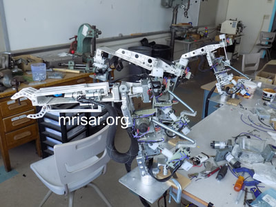 MRISAR's team making parts for our interactive regular or Telepresence exhibit grade 5 Finger Robot Arms! We sell them as kits, or as a complete exhibit, in our standard cases or in a custom case. We have been making exhibit robotics since 1991.