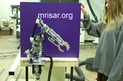 MRISAR's team member Autumn Siegel seen here during the testing of a custom ordered miniature exhibit grade 5 finger Robot Arm kit! We sell them as kits, or as a complete exhibit, in our standard cases or in a custom case. We have been making exhibit robotics since 1991.