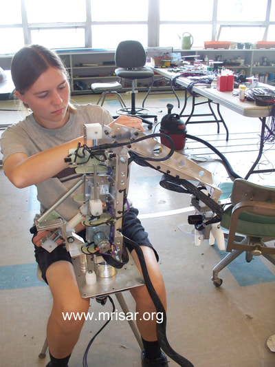 MRISAR's Team member Autumn Siegel fabricating a Robotic Arm exhibit kit.