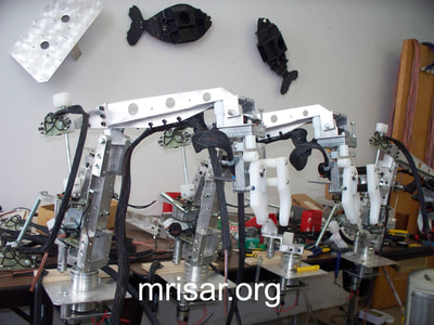 MRISAR's Team fabricating parts for our interactive regular and teleoperated exhibit grade 3 and 5 finger robot arms. We sell them as kits or installed into our standard cases or in custom ordered cases. We have been making exhibit grade robotics since 1991.