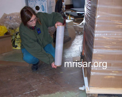 MRISAR Team member Aurora Siegel, prepping for shipping our Robotic Arm exhibits.