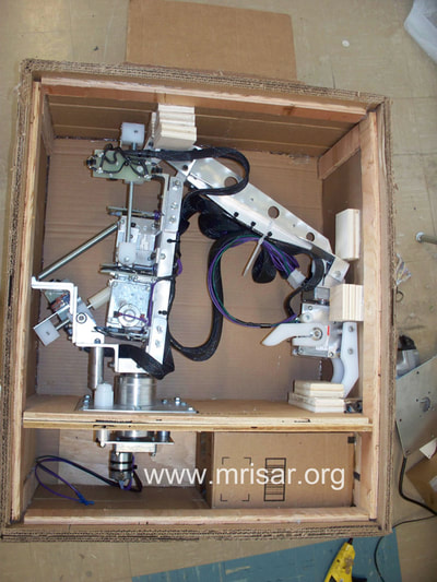 MRISAR's 3 Finger Robotic Arm exhibit kits. We make custom shipping crates for our robotic kits.