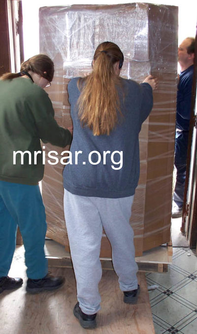 MRISAR Team members Autumn Siegel and Aurora Siegel, prepping for shipping our Robotic Arm exhibits.