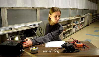 Interactive Science Exhibit; Super Photonic Pentiductor Exhibit, designed and fabricated by MRISAR. We have been making them since 1993. MRISAR's team member Autumn Siegel, making a Super Photonic Pentiductor Exhibit.