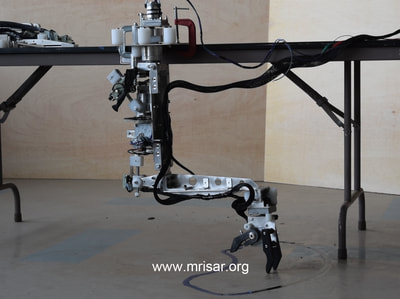 Robotic Exhibits; MRISAR's Top mounted 3 Finger Robotic Arm Exhibit. MRISAR has designed and fabricated the earth's largest selection of world-class, public use, interactive robotic exhibits.