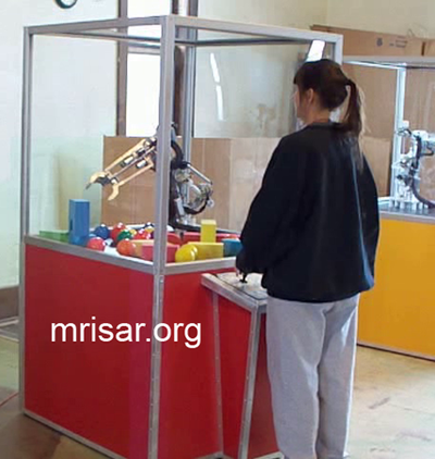 MRISAR's Team member Victoria Croasdell Siegel fabricating Robotic Arm exhibits.
