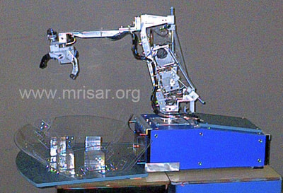 Robotics Interface Device with Facial Feature Controlled Robotics and Artificial sense of touch. MRISAR's circa 2002 Rehabilitation Robotic; Facial Feature Controlled Activity Center, For Paralysis Victims.