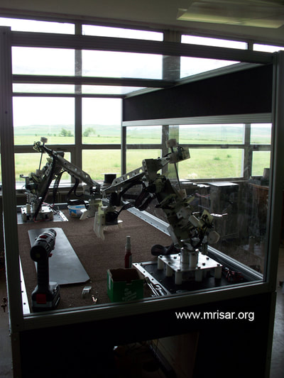 MRISAR's R&D Team members fabricating  Dual Combo Robotic Arm exhibits.