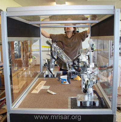 MRISAR's R&D Team member John fabricating a Dual Combo Robotic Arm exhibit.