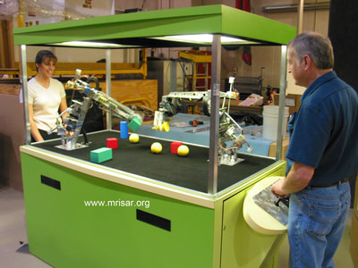 MRISAR's 5 Finger and 3 Finger Robot Arm Kits that were incorporated into a customer's own exhibit case.
