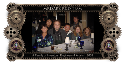 MRISAR's R&D Family Team Members; from left; Victoria Lee Croasdell, John Adrian Siegel, Autumn Siegel, Michael Cook and Aurora Siegel, 2003. The team is shown here at a dinner party hosted by IEEE RO-MAN 2003; International Workshop on Robot and Human Interactive Communication, during convention in San Francisco, where they presented their philanthropic work in rehabilitation robotics for the disabled. They met other robotic inventors from all over the world there. Victoria's youngest son Michael, who also works for MRISAR and is an inventor, joined them. The conference was sponsored by: IEEE Industrial Electronics Society, Robotics Society of Japan, Hosei University, Hosei University Research Institute, California, New Technology Foundation. Technical Sponsors: IEEE Robotics and Automation Society, Virtual Reality Society of Japan. With Additional Support from Faculty and Staff of: Stanford University, VA Palo Alto Health Care System, Immersion Corporation, Intuitive Surgical Inc.